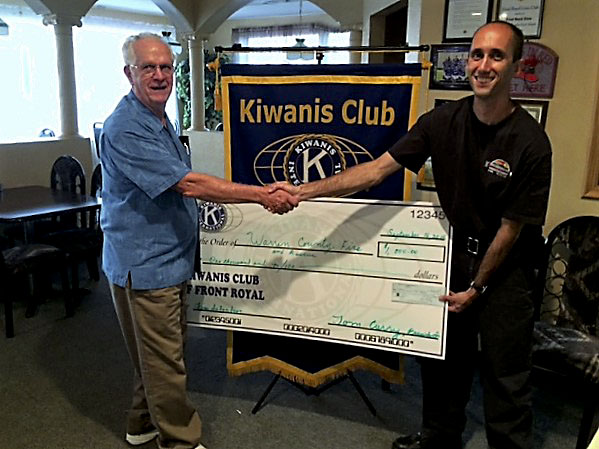 Front Royal Kiwanis President Tom Curry, left,  presents a $1,000 check to Warren County Fire and Rescue Services emergency manager  Shawn Graber. The donation will benefit the local smoke detector program. Courtesy photo