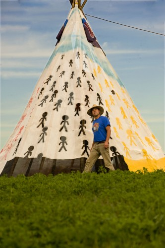 Chris (Comeswithclouds) White, of Bluemont, walks around a teepee he designed and constructed at Clermont Farm at the intersection of East Main Street and Va. 7 in Berryville. The teepee is being used to help advertise The Gathering, a festival that includes Kidz Harvest Fest, Harvest Dance and the Virginia Gourd Festival Oct. 30-Nov. 1. Rich Cooley/Daily
