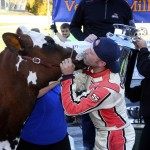 Milk Bowl winners traditionally kiss a cow in Victory Lane, and in 2015 that honor went to Nick Sweet.  Courtesy photo by Alan Ward