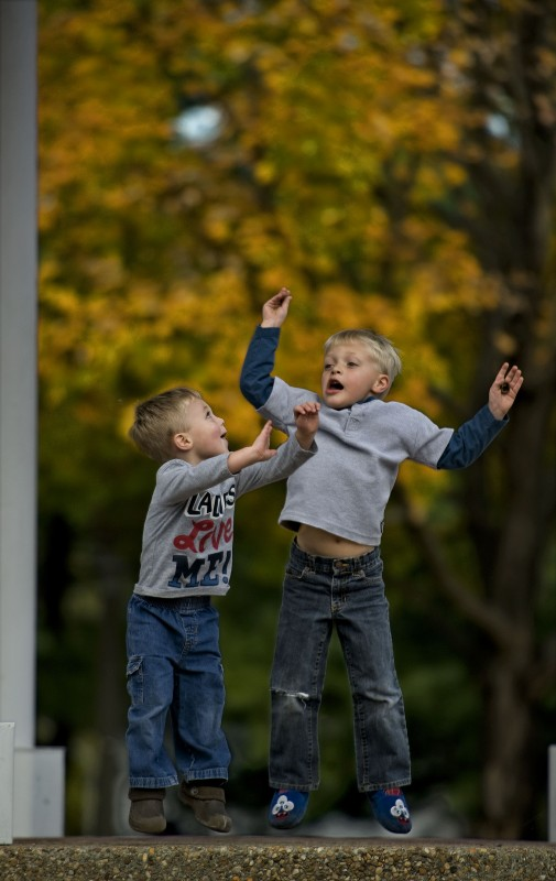 Wesley Grindle, 2, at left, and his brother Brently, 4, play inside the gazebo on East Main Street in Front  Royal on a colorful fall afternoon.    Rich Cooley/Daily
