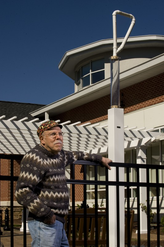 John Kovac, of Front Royal, stands beside the Aeolian harp he constructed for the Norman H. and Elsie Stossel Upchurch Children's Garden in front of Samuels Library along Criser Road in Front Royal.  The harp has 12 strings and is topped by a PVC harp of about 22 strings. Rich Cooley/Daily