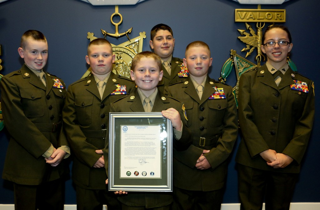 Shenandoah Valley Young Marines show off their award they received at the Pentagon. Receiving the award were, from left,  Michael Jeziorowski, 11, of Stephens City; Bryan Buck, 12, of Stephens City; Homer Nester, 9, of Winchester; Jarod Corder, back row, 14, of Middletown; Thomas Buck, 11, of Stephens City; and Loressah Clemons, 17, of Inwood, West Virginia. Courtesy photo