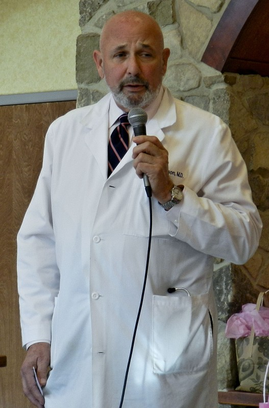 Dr. Kenneth Mason, of Woodstock Surgical Clinic, talks about breast cancer during an event at  Shenandoah Memorial Hospital on Thursday afternoon. Kaley Toy/Daily