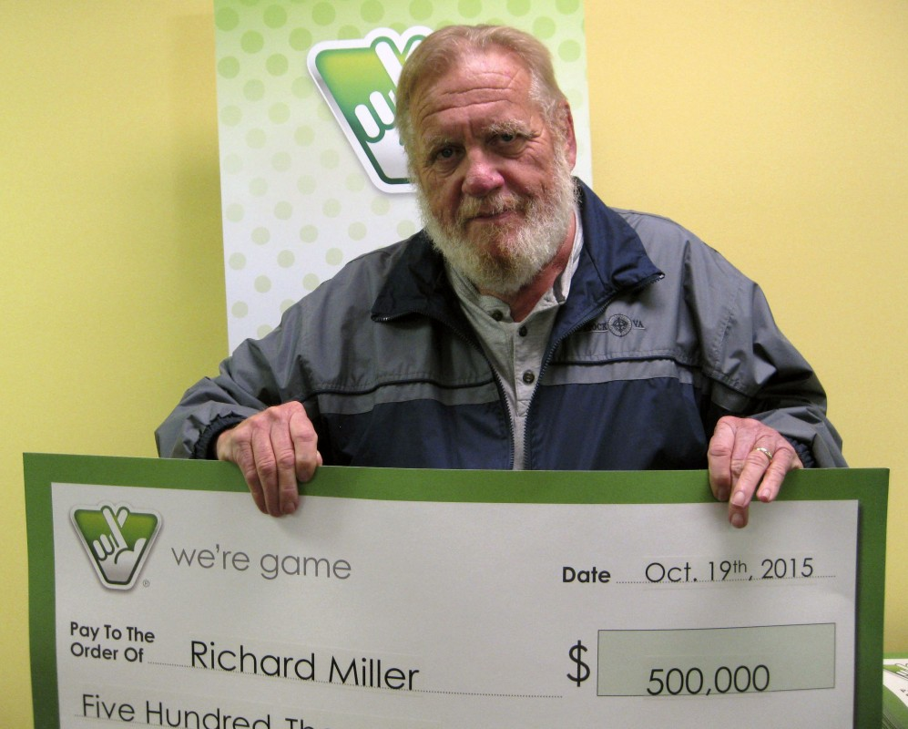 Richard Miller, of Woodstock, holds his winning check for $500,000 from the Virginia Lottery. Courtesy photo