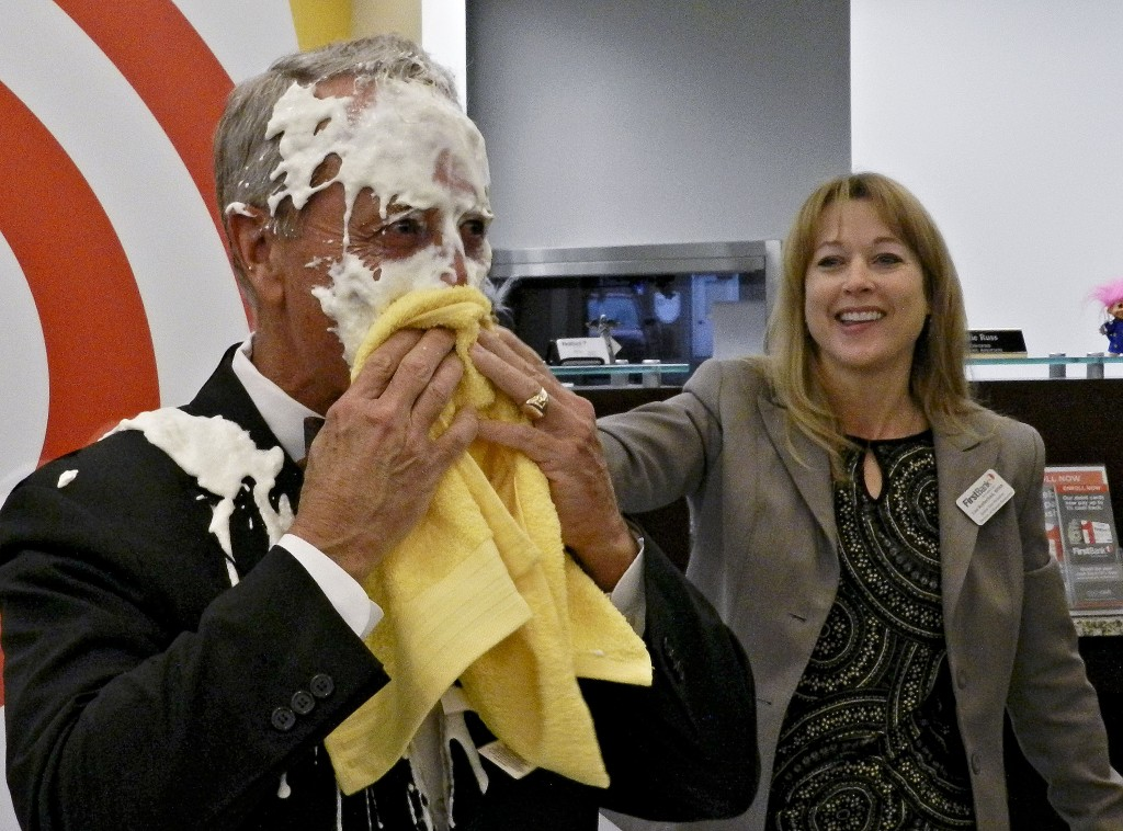 First Bank CEO Scott Harvard got a surprise faceful of pie at the quarterly lobby meeting celebrating a United Way contribution of more than $45,000. Rachel Mahoney/Daily