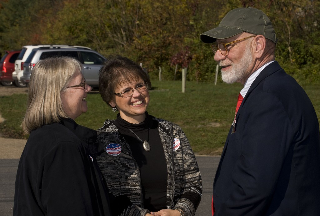 Shenandoah Clerk of Court candidate Sarona Irvin, center, chats with Denise Estep, left,  clerk of court, and former commonwealth's attorney Al Mitchell, right at Central High School in Woodstock. Rich Cooley/Daily