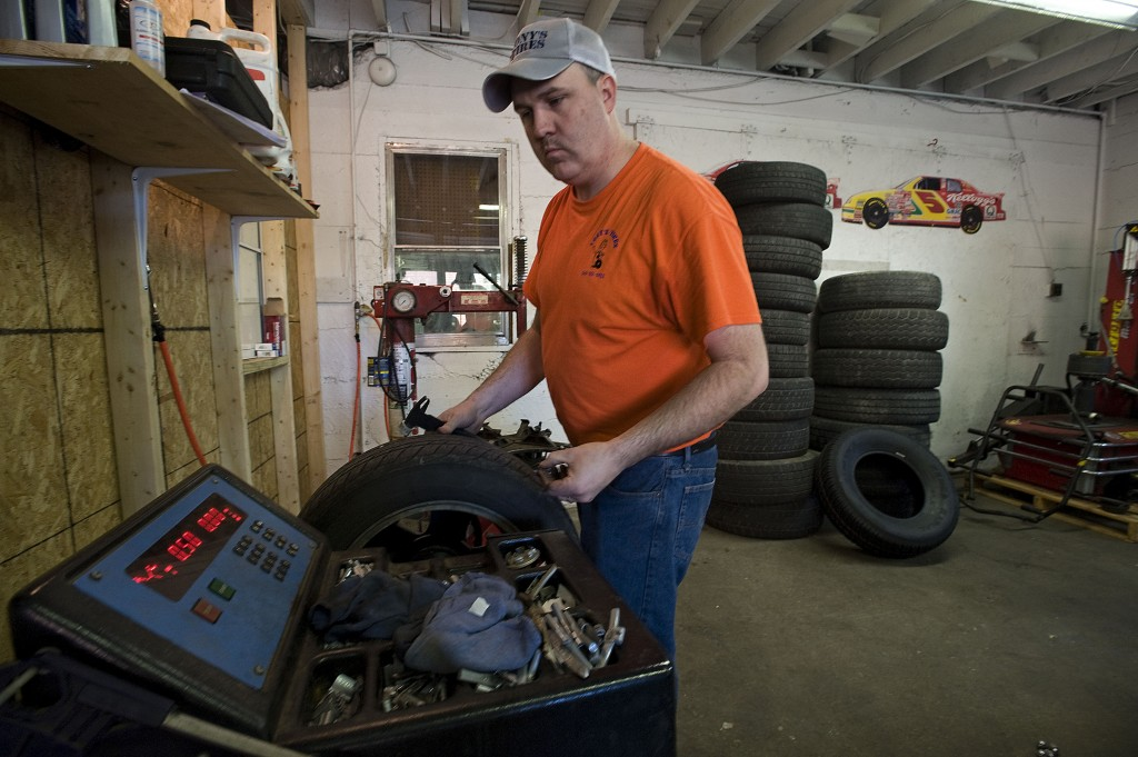 Tony Partlowe balances a tire inside his shop on East 7th Street in Front Royal. Partlow opened Tony's Tires in May for area car owners looking for affordable name-brand and vintage tires. Rich Cooley/Daily