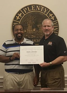 Warren County Deputy Finance Director Andre Fletcher, left, poses with Warren County Administrator Doug Stanley after receiving a Virginia Government Finance Officers' Association and Radford University Government Nonprofit Assistance Center certificate on Oct. 22.  Courtesy photo