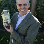 """Christmas Jars"" author Jason Wright and Northern Virginia Daily guest columnist holds a jar filled with money. Christmas Jar money is saved throughout the year for someone in need."