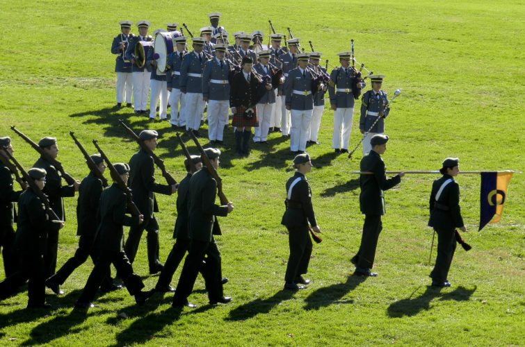 Massanutten Military Academy Cadets cross the Gordon D. Bowman Stadium field in Woodstock on Wednesday during a Veterans Day program . Kaley Toy/Daily