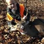 Sam Lutz, 9, son of Herbie Lutz of  Woodstock, took this 8-point buck on opening day of rifle season. This is his first buck.   Courtesy photo by Herbie Lutz
