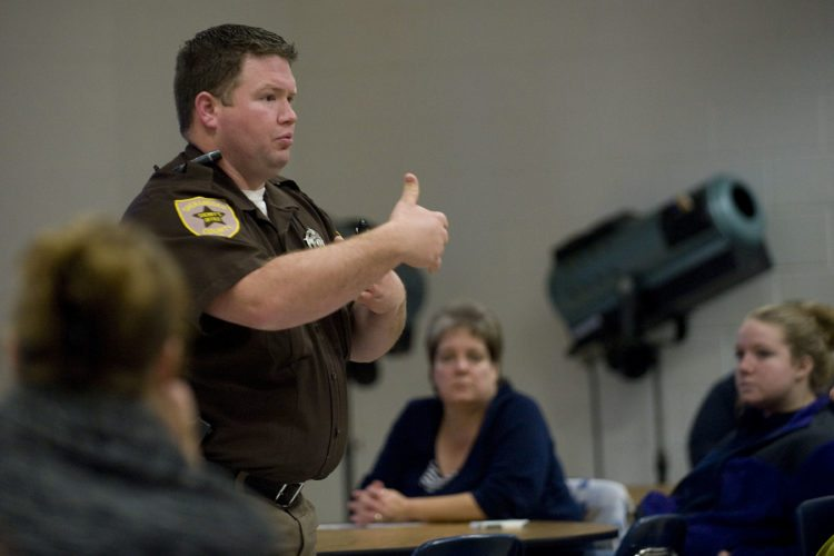 Shenandoah County school resource officer deputy Ricky Miller speaks to this group of parents and teenagers on the hazards of distracted driving at Central High School Tuesday evening. Rich Cooley/Daily