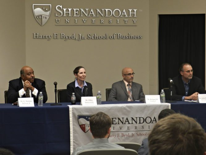 From left, University of North Florida professor E. Newton Jackson Jr., professor of sport management at Drexel University Ellen Staurowsky, College Sport Research Institute Director Richard Southall and former associate commissioner for compliance and academic affairs for the NCAA's Southeastern Conference John Gerdy served as panel members for a symposium focusing on NCAA issues at Shenandoah University on Monday evening.   Brad Fauber/Daily