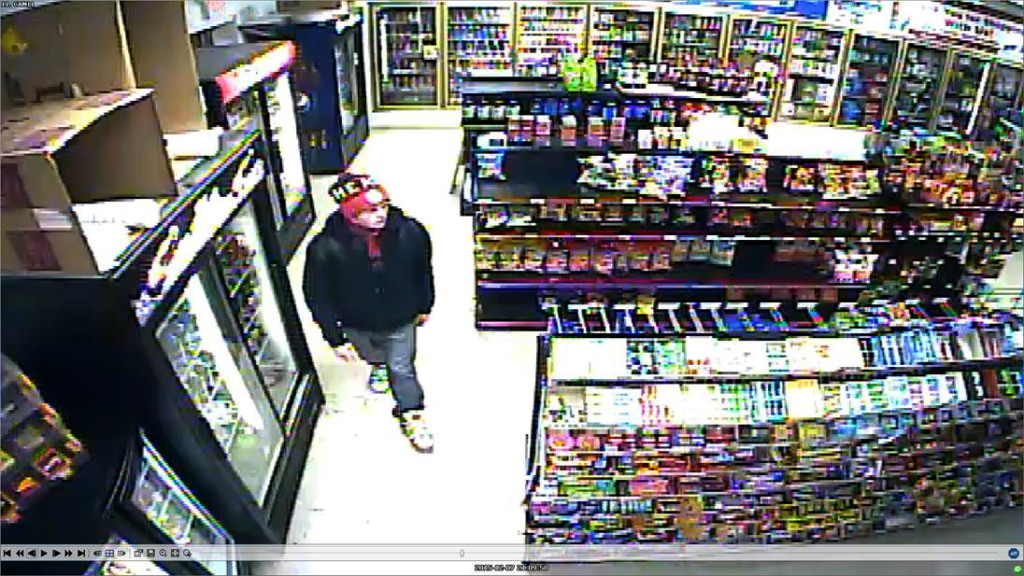 Police released this image from a surveillance video taken at JR Food Mart near Stephens City at around 9 p.m. Monday.  This man is believed to be a suspect in an armed robbery there.