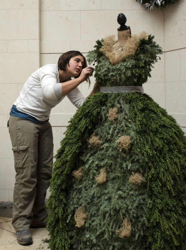 Chantal Ludder, horticulturalist at the Museum of the Shenandoah Valley, finishes her holiday decoration dress at the museum with a sprig of yew. Photo courtesy of Perry Mathewes