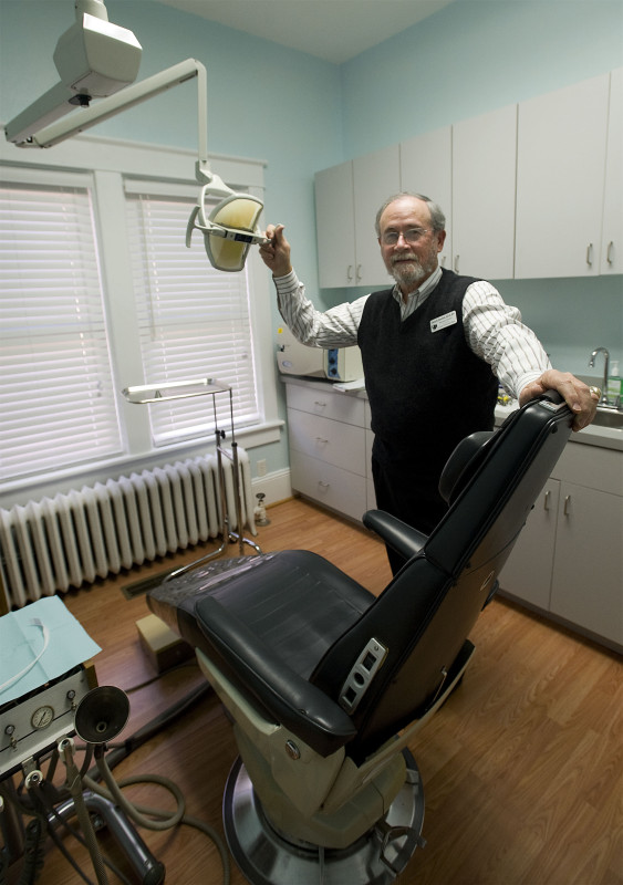 Glenn Burdick, executive director of St. Luke Community Clinic in Front Royal, stands inside the new dental exam room that the clinic has added for patients.   Rich Cooley/Daily