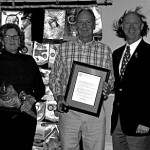 Kevin Cannon, center with his wife Judy, left and District Governor, Alex Wilkins,right presenting Kevin with the District Governor's Citation