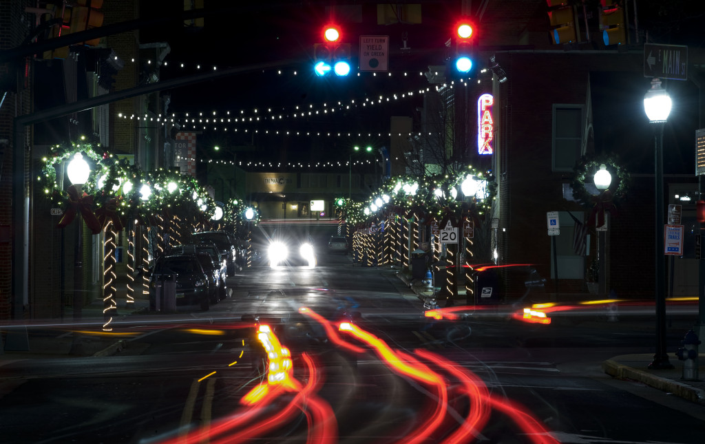 Car tail lights illuminate this scene onto Front Royal's Main Street, which is lined with Christmas lights.   Rich Cooley/Daily