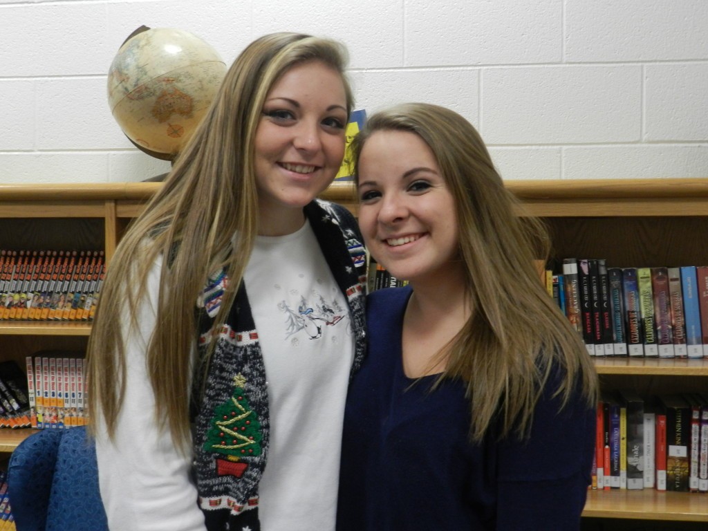 Central High School juniors and FCCLA officers, Erika Thorpe, left, and Gwyneth George hosted a childhood cancer event at the boys basketball game on Dec. 17 and raised almost $1,000.  Kaley Toy/Daily