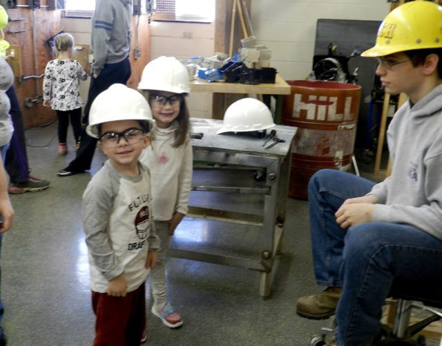 Triplett Tech preschoolers Rhett Hamilton, 4, left, and Hannah Dettmer, 4, center, learn about safety precautions from Jacob Stephens, right, a second-year electricity student. Kaley Toy/Daily