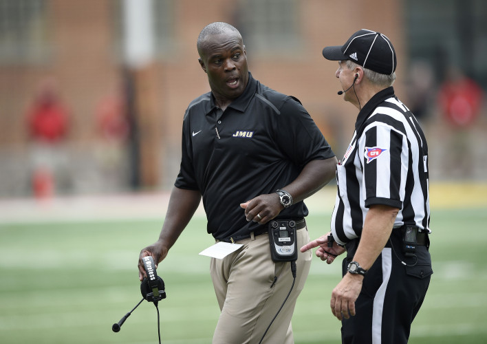 James Madison head coach Everett Withers, left, talks to an official during a game against Maryland on  Aug. 30, 2014, in College Park, Md. Withers resigned as JMU coach on Wednesday to become head coach at Texas State. AP file Photo/Nick Wass)