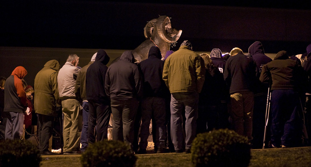 After the Strasburg High School boys basketball program was suspended, Strasburg residents showed their support  for the community during a Jan. 19 prayer vigil next to the ram statue at the school.  Rich Cooley/Daily