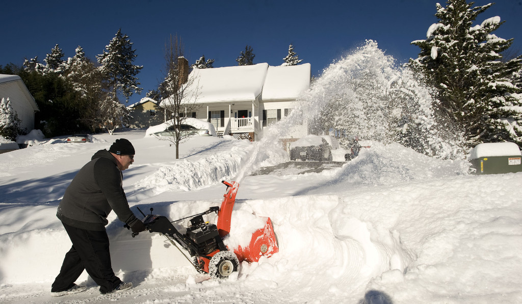 Paul Zdepski works on clearing his neighbor's driveway along Dickerson Lane in Strasburg on Jan.  24. Rich Cooley/Daily