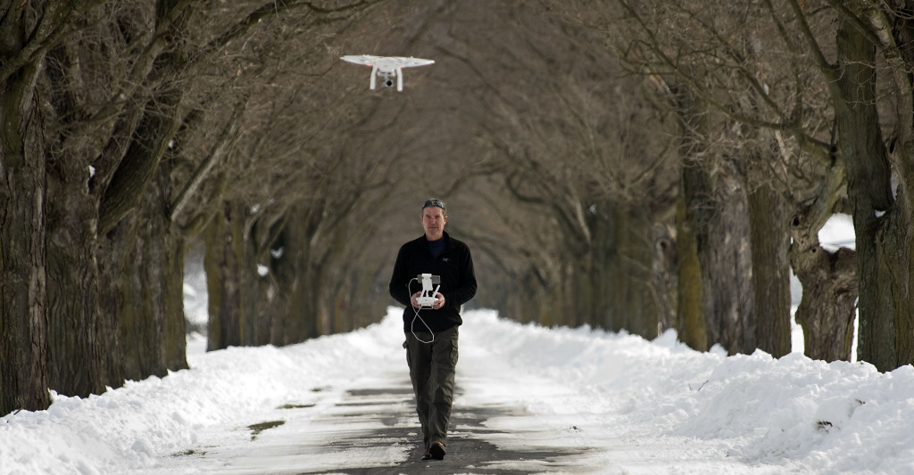 Will Bain, of New Market, flies his drone along a tree-lined stretch of Mt. Airy Lane in Mount Jackson on Tuesday.  Rich Cooley/Daily