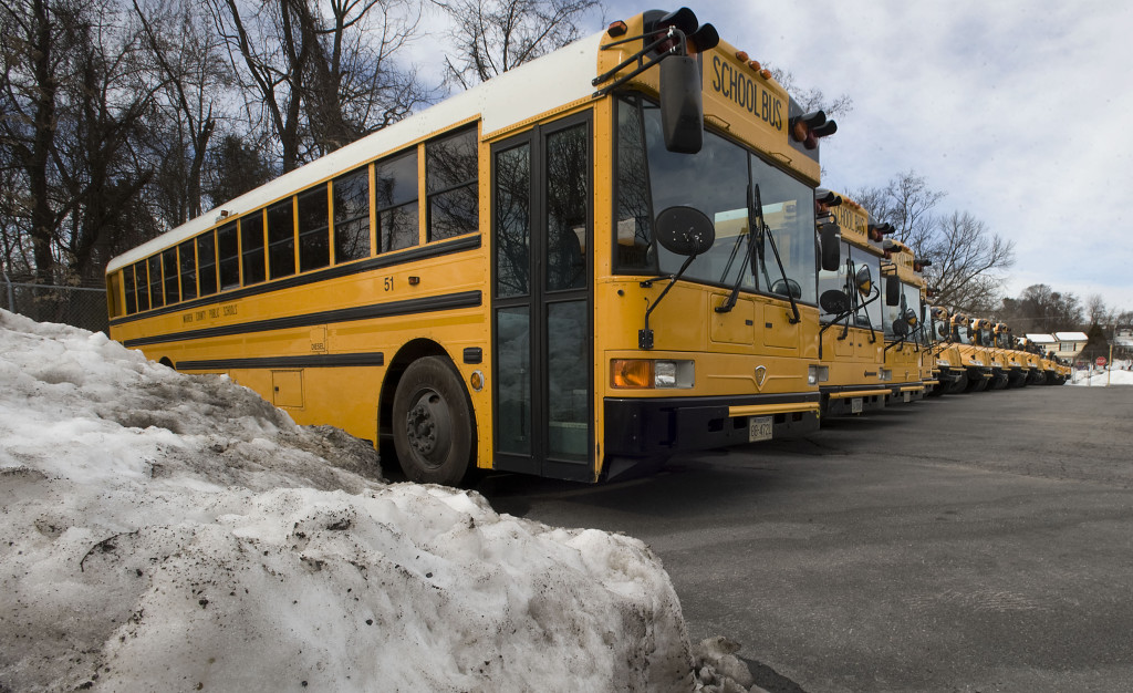 School buses are parked at the Warren County Public School's Transportation Department on Criser Road in Front Royal on Thursday. Public schools in Warren and Frederick counties are closed today due to last weekend's blizzard.  Shenandoah County schools were already scheduled to be closed today.  Rich Cooley/Daily
