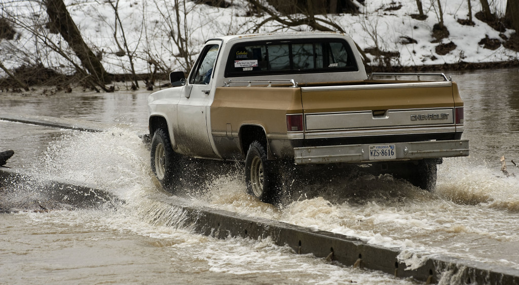 A truck drives through standing water from the North Fork of the Shenandoah River along South Hollingsworth Road in Woodstock on Tuesday. The National Weather Service is forecasting rain for most of today with temperatures in the mid 60's and the potential of flooding. Rich Cooley/Daily