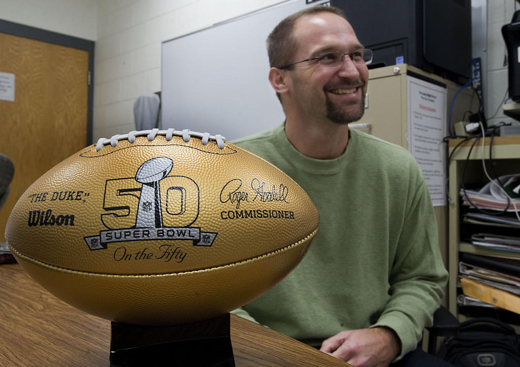 Sherando High School football coach Bill Hall talks about the school's National Football League  gift on behalf of former Sherando student Kelly Washington.   Rich Cooley/Daily