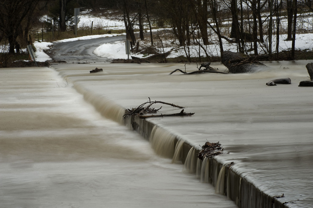Floodwaters from the Shenandoah River flow over the Artz Road bridge east of Woodstock on Wednesday. Area rain and melting snow made waters rise throughout the region.  Rich Cooley/Daily