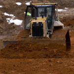 A bulldozer performs site work along the Leach Run Parkway project.  Rich Cooley/Daily
