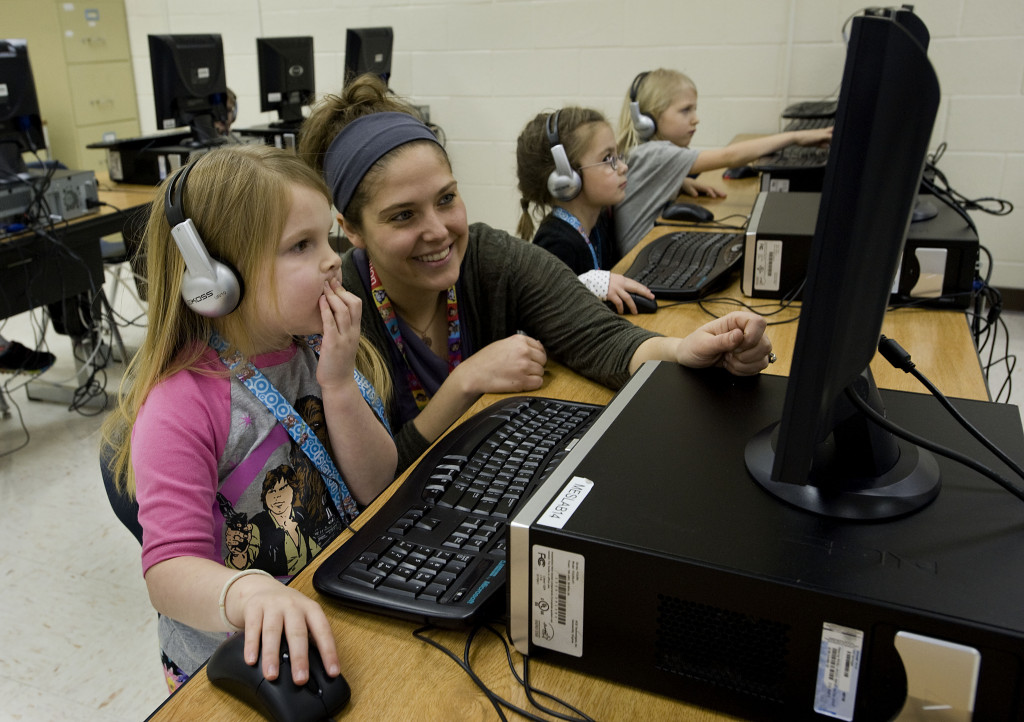 Middletown Elementary kindergarten teacher Beth Ballard sits beside Virginia Barr, 5, during computer lab class at the school recently. Ballard has received recognition for her applications of a progress monitoring classroom tool used across the nation.  Rich Cooley/Daily