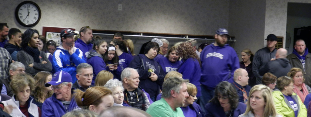 Area residents – many wearing purple, Strasburg's school color – showed up at Thursday's Shenandoah County School Board meeting to offer opinions on the boys' basketball program and the alleged assault on a team bus.  Kaley Toy/Daily