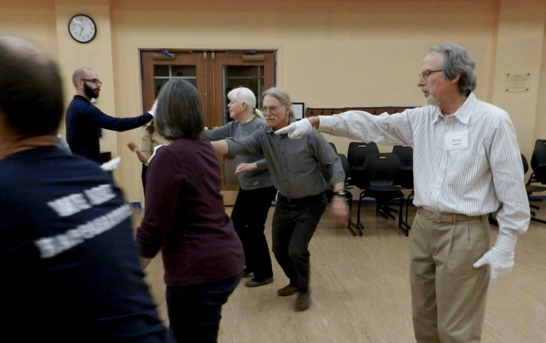 Tom Mack directs different moves during the Shenandoah Valley Civil War Era Dancers' February practice session at Samuels Library in Front Royal. Rachel Mahoney/Daily
