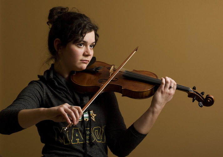 Katelyn Dill, 17, practices on her violin inside her Edinburg home. Katelyn recently performed with the 2016 National High School Honors Symphony Orchestra at Carnegie Hall in New York City.  Rich Cooley/Daily