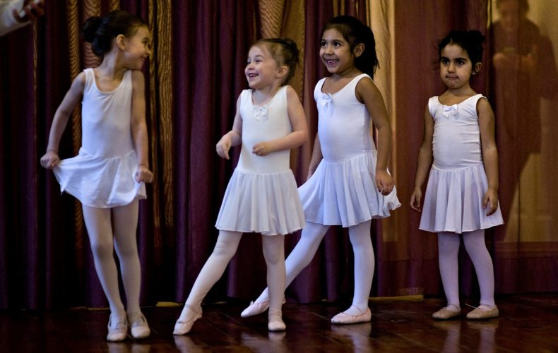 Young girls in the Pre Primary 2 ballet class giggle during a recent session at the Italia Performing Arts ballet studio in Edinburg. Rich Cooley/Daily