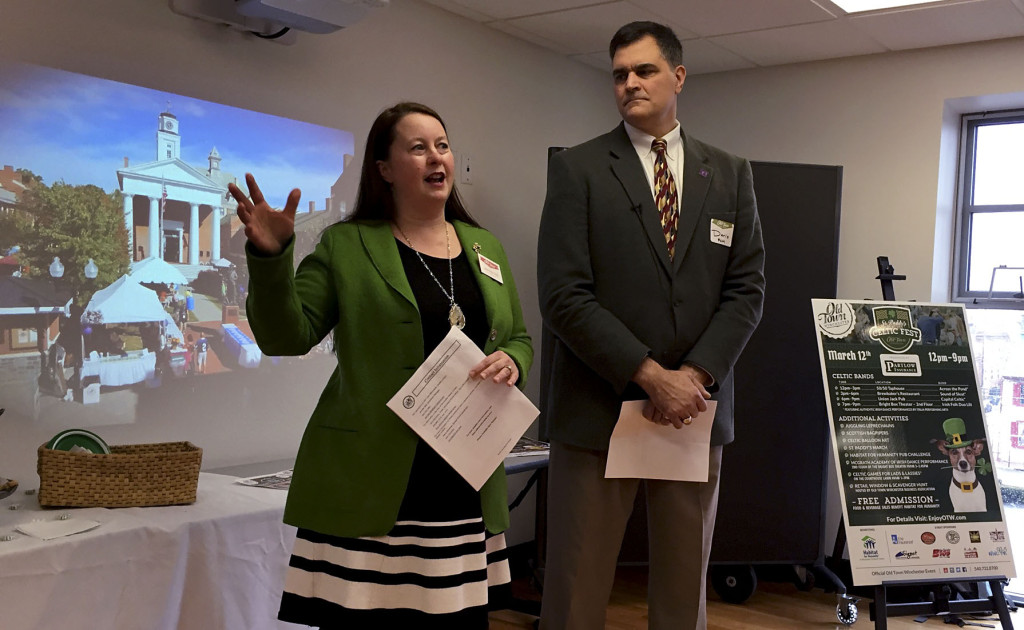 Jennifer Bell, left, Winchester's downtown manager, and Dario Savarese, Full Circle Marketing founder and president,  introduce community partners to Old Town Winchester's new St. Paddy's Celtic Fest, scheduled for March 12. Rachel Mahoney/Daily
