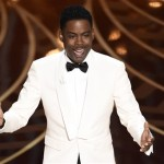 Host Chris Rock speaks at the Oscars on Sunday at the Dolby Theatre in Los Angeles. AP