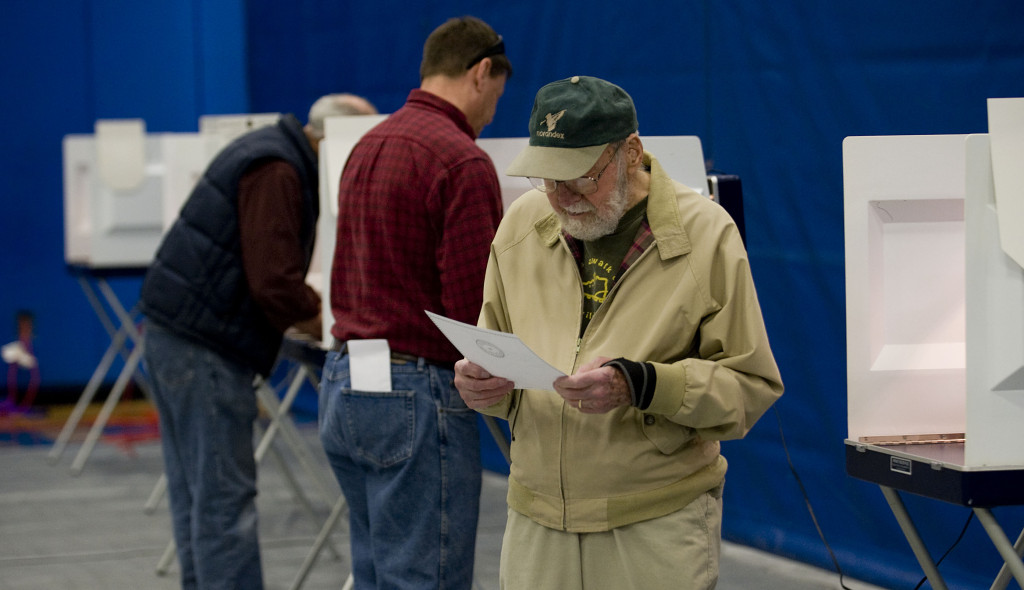 Edward De Cristofano, 90, of Woodstock, rechecks his ballet after voting in the presidential primary election Tuesday morning at Central High School in Woodstock.  Rich Cooley/Daily