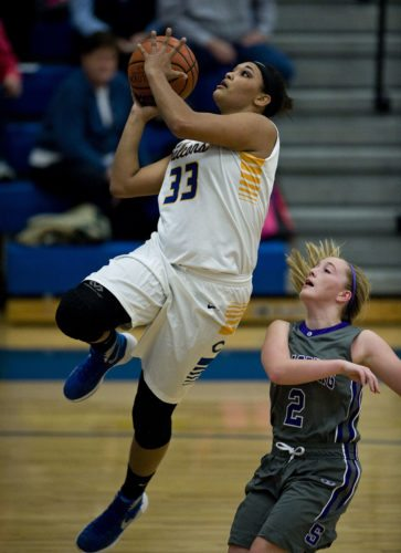 Central's Tamra Scott goes up for layup in the Jan. 15 game against Strasburg. Scott is the Daily's girls basketball player of the year. Rich Cooley/Daily
