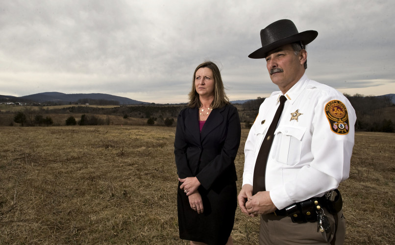 Jennifer R. McDonald, left, executive director of the Warren County Economic Development Authority, and Warren County Sheriff Danny McEathron stand on a parcel of land at the end of Progress Drive in Front Royal that will be the future site of an $8 million regional criminal justice training facility.  Rich Cooley/Daily
