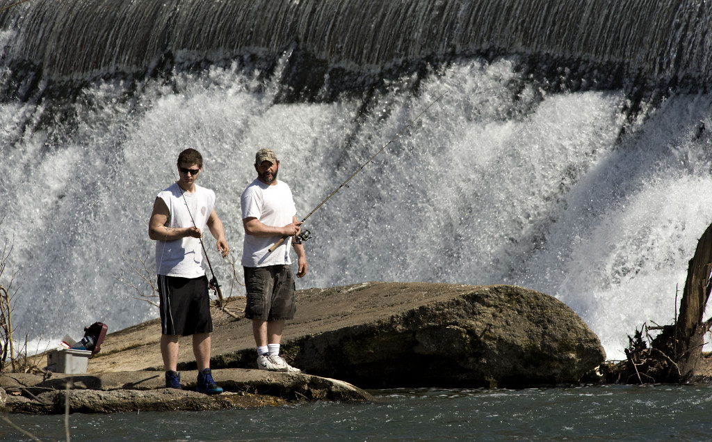 A pair of anglers fish in the Shenandoah River during spring-like weather along Burnshire Dam east of Woodstock. Today's high will be around 60, but expect cooler temperatures – with a chance of rain and snow – this weekend.  Rich Cooley/Daily