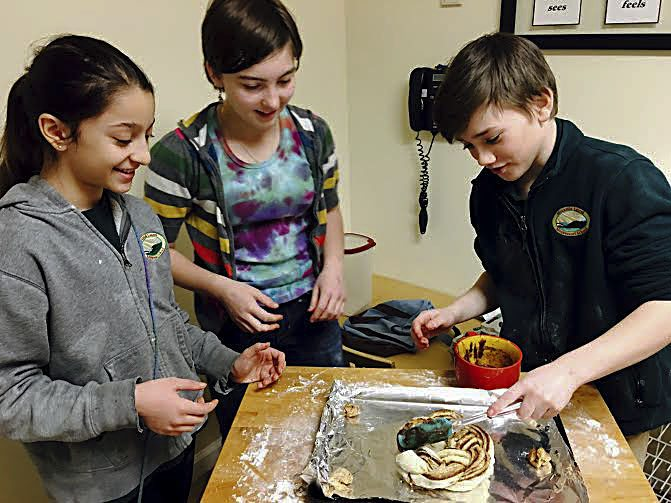 Mountain Laurel Montessori School  students, from left, Sabrina Sabahi, Lillie Burbulis and Zachary Bell, cook Estonian treats to share with the school the community.   Courtesy photo