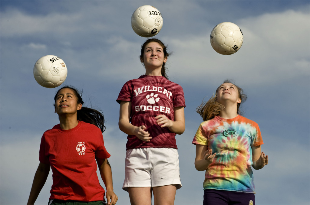 Warren County 's Lisette Moya, left, Courtney L'Amoreaux, center,  and Shauna Sayers, right, will lead the Lady Wildcats this spring in girls soccer.   Rich Cooley/Daily