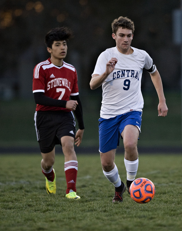 Central's Benjamin Truban kicks the ball down the field as Stonewall's Carlos Romero-Hernandez trails him in a game earlier this season. The Falcons host Bull Run District rival George Mason on Tuesday.   Rich Cooley/Daily