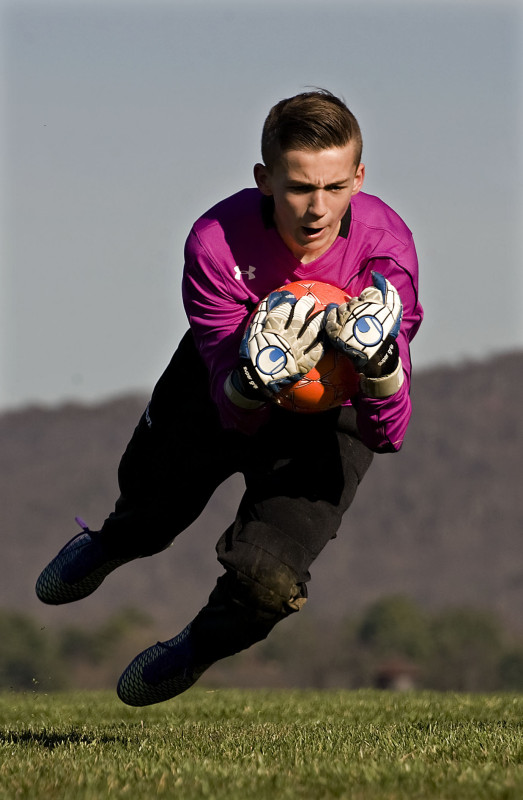 Bryce Peacock, a goalkeeper for the state Olympic Development Program, dives for a ball in March in Front Royal. Peacock, 12, was selected to the Region I ODP ID camp in November in Arizona. Rich Cooley/Daily file