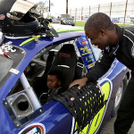 NASCAR K&N Pro Series West driver Jesse Iwuji lets 4-year-old cancer patient Darrian Nordstrom sit in the driver's seat before taking him for a ride. Courtesy photo