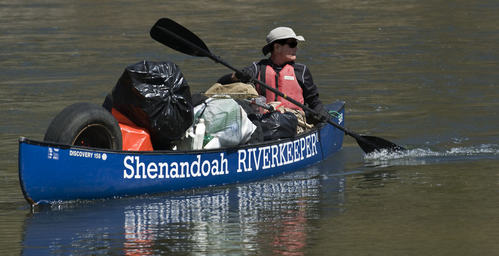 Alan Lehman, Shenandoah Riverkeeper program manager, floats in a canoe loaded with trash he picked up on a recent morning near Camp Lupton east of Woodstock. Shenandoah Riverkeeper adopted this stretch from Camp Lupton to Burnshire Dam. The group is looking for other organizations to assist in adopting other stretches of the river to clean. More information: http://tiny.cc/n7tkay   Rich Cooley/Daily